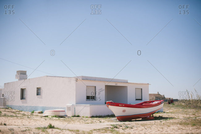 March 6, 2014: House and boat on beach, Portugal