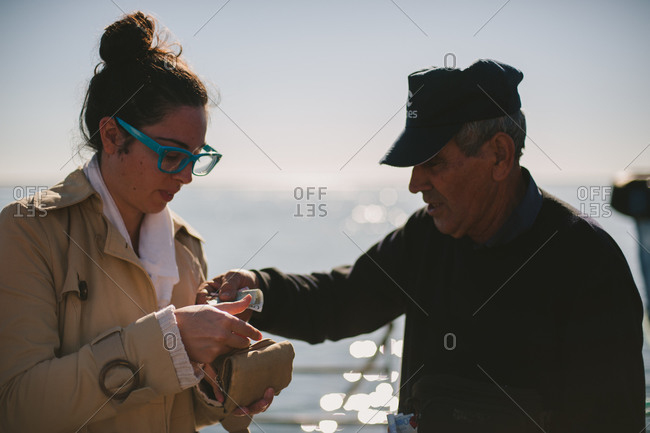 March 6, 2014: Woman buying ferry ticket