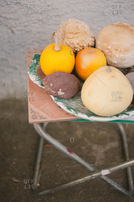 Various gourds on a chair