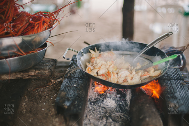 Seafood cooking in pan