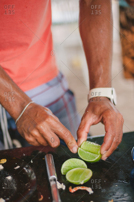 Man preparing limes for cooking