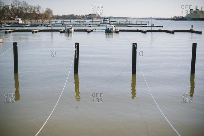 Posts near marina, Finland - Offset