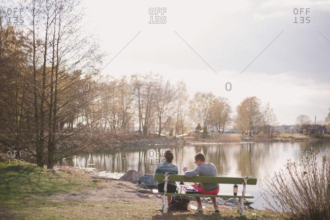 Couple on waterfront, Helsinki, Finland