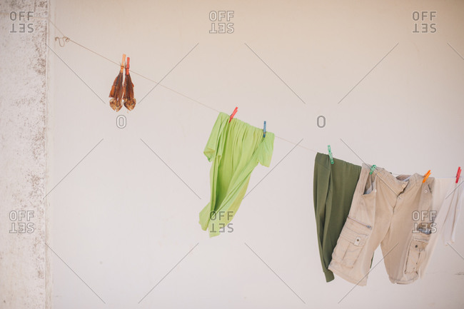 Clothes hanging by a wall