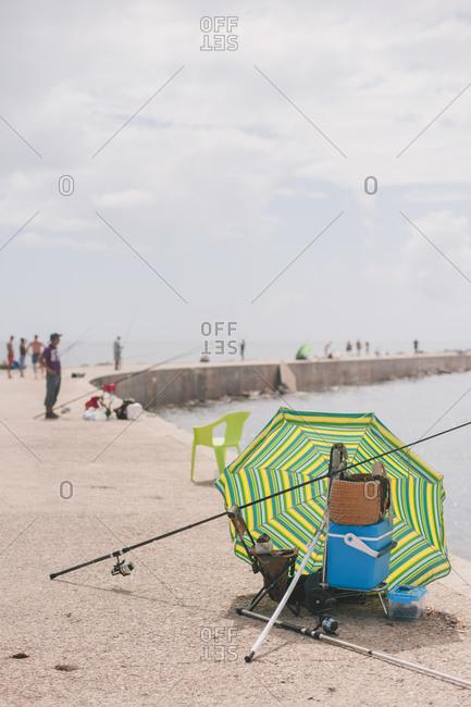 Umbrella and fishing gear on dock