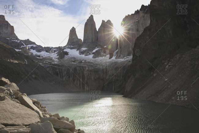 Sunlight streaming through mountains