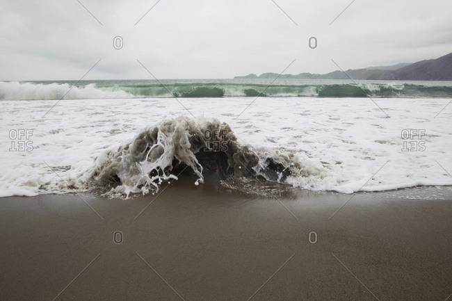 Water splashing on shore