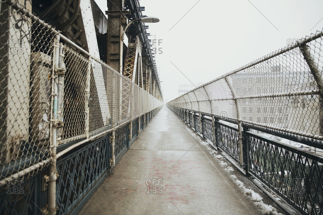 Walkway on Brooklyn Bridge against clear sky