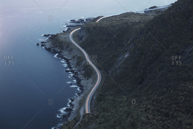 High angle view of long exposure on mountain road at night