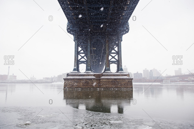Low angle view of bridge over river against sky