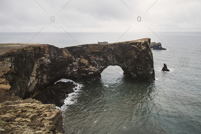 Natural arch on sea at Dyrholaey