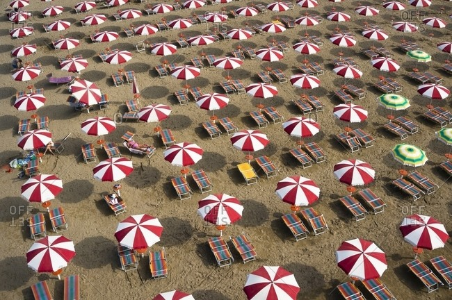 Aerial view of umbrellas at Caorle beach, Italy