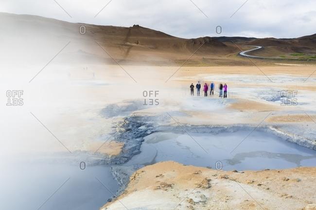 Hverarond, Iceland - August 21, 2015: People walking near geothermal area at Myvatn Lake