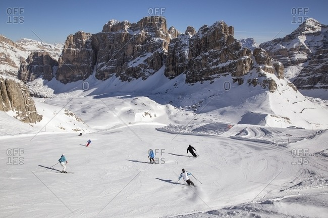 Group of skiers on the slopes below the Fanis group and Tofana di Rozes, Italy
