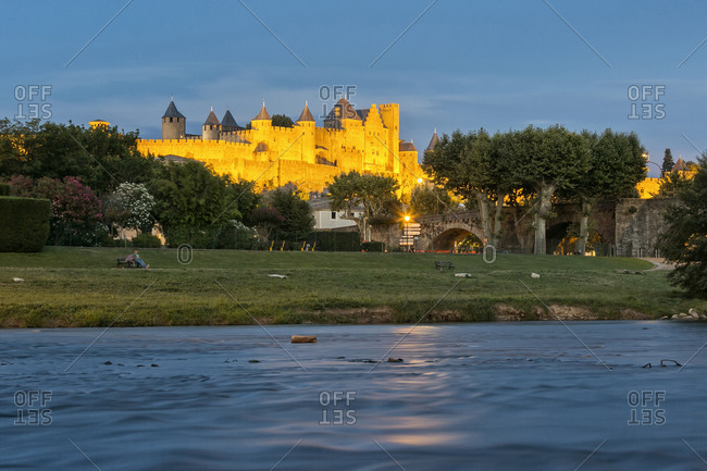 View of the mediavel ancient city of Carcassonne at night time from Aude river, Carcassonne, Languedoc-Roussillon, France