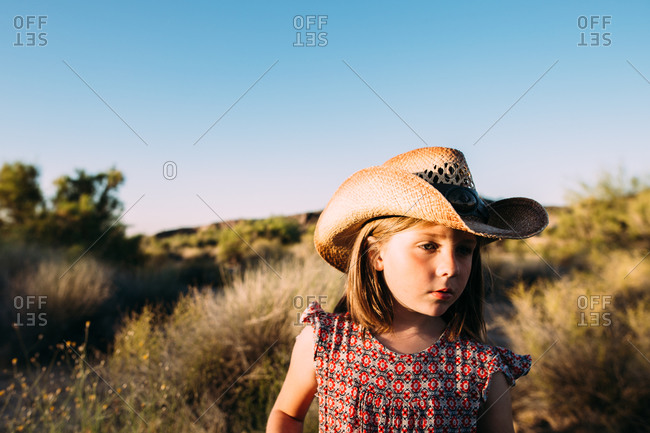Girl in a cowboy hat in the desert