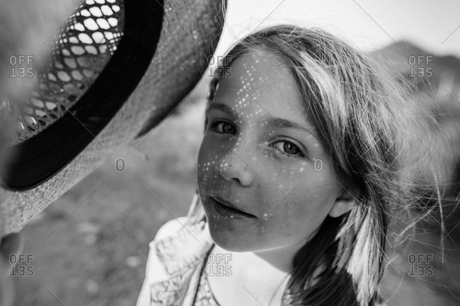 Portrait of a girl wearing a cowboy hat