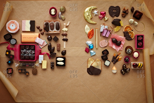 An assortment of chocolate pieces arranged on parchment paper