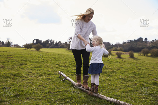 Mother And Daughter On Winter Country Walk