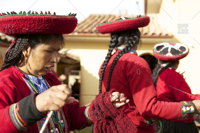 Chinchero, Peru - April 4, 2013: Woman winding yarn