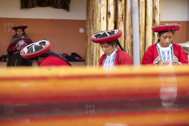 Chinchero, Peru - April 4, 2013: Woman making textiles