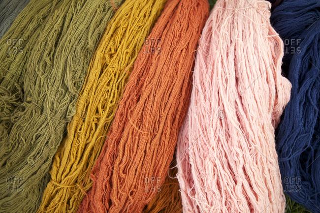 Various bundles of hand dyed yarn
