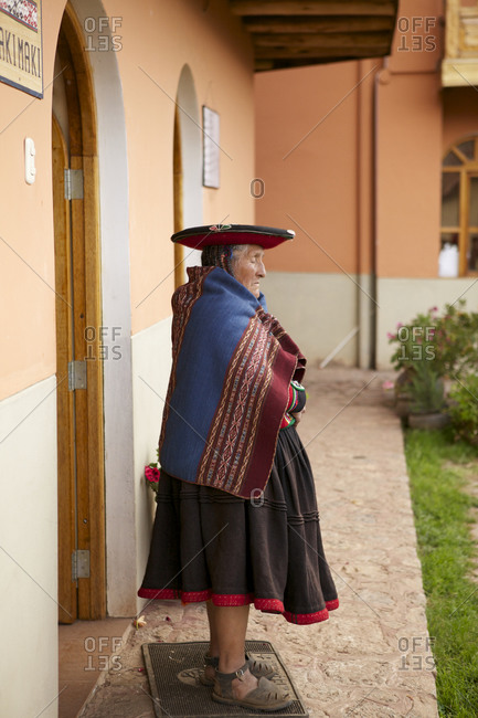 Chinchero, Peru - April 4, 2013: Woman standing in front a doorway