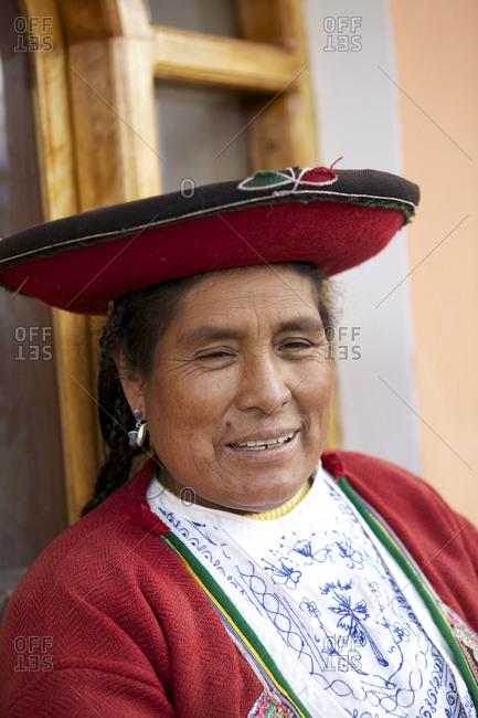 Chinchero, Peru - April 4, 2013: Portrait of a woman smiling in traditional clothing in Chinchero, Peru_
