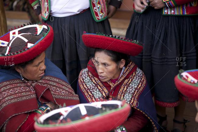 Chinchero, Peru - April 4, 2013: Woman wearing traditional clothing talking