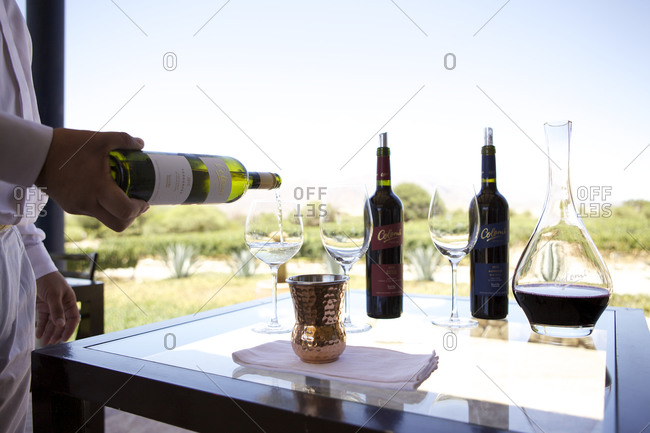 Colome Salta, Argentina - February 3, 2016: Man pouring wine for a wine tasting at Colome, Argentina