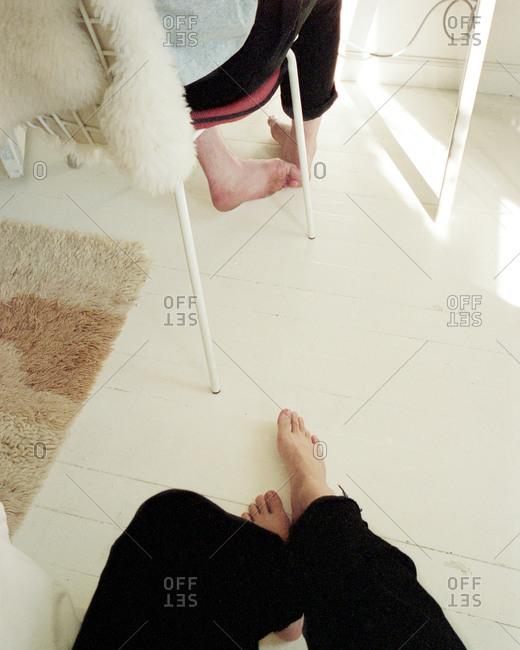People's feet on painted wooden floor
