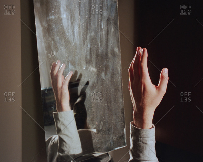 Hand reflecting in a mirror
