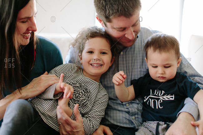 Close-up portrait of parents with two young children
