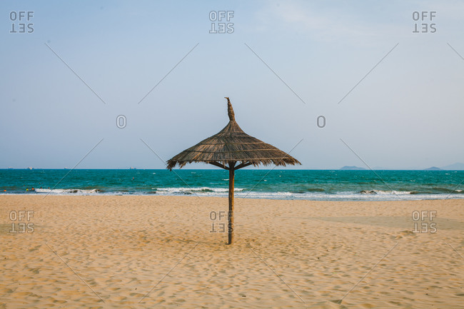 Thatched umbrella on a beach in Quy Nhon, Vietnam
