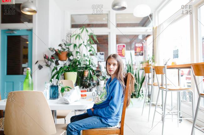 Girl sitting at a restaurant