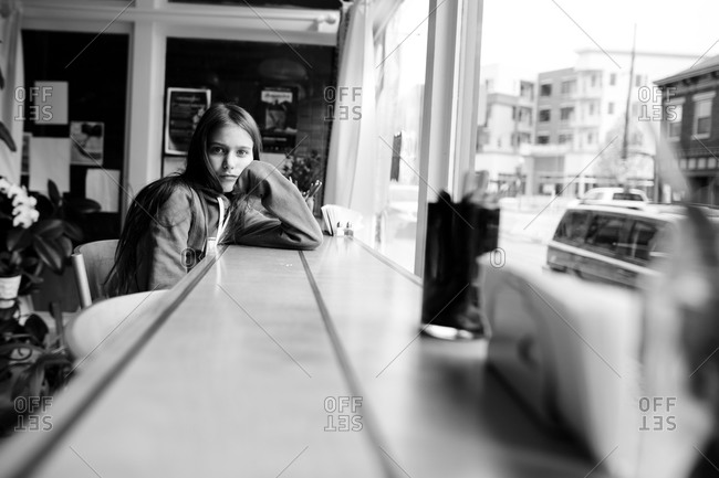 Girl at a restaurant window