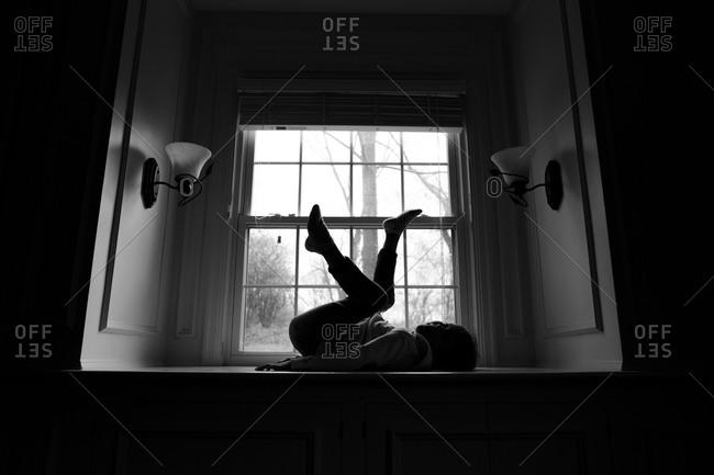 Girl dancing on a window seat