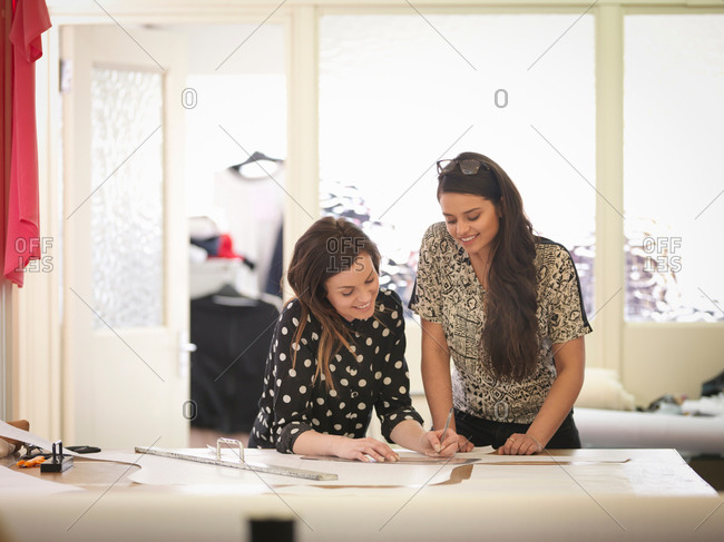 Fashion designers working together in fashion studio