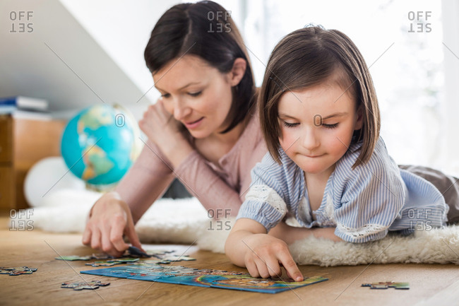 Mother and daughter doing jigsaw