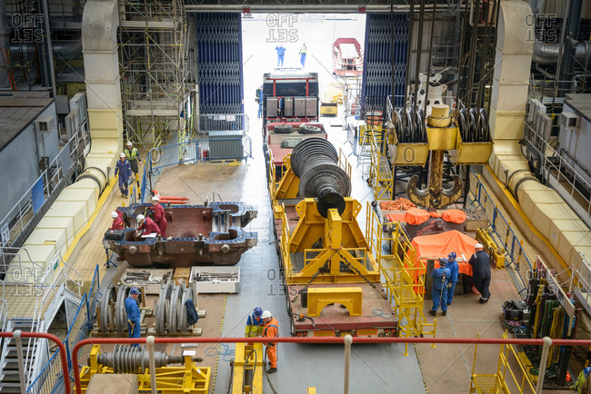Turbine on truck in turbine hall during power station outage, high angle view