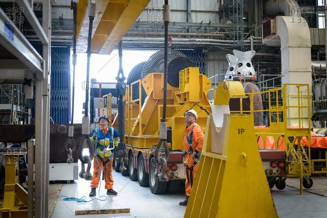 Banksman and crane operator working together to lower a crane to turbine hall