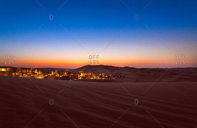 Abu Dhabi, United Arab Emirate - April 15, 2014: Qasr Al Sarab in the Empty quarter of the Rub'tl Khali desert at  twilight
