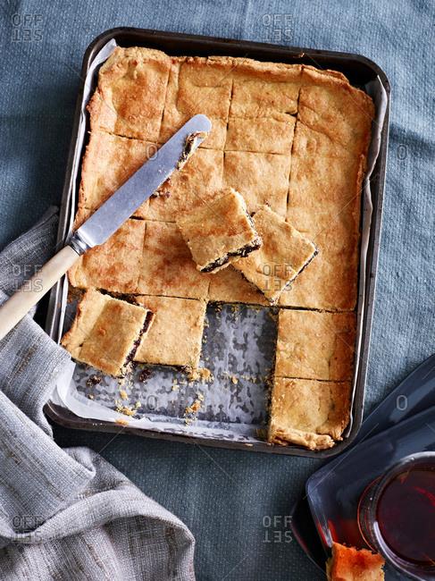 Still life of baking tray with garibaldi slices
