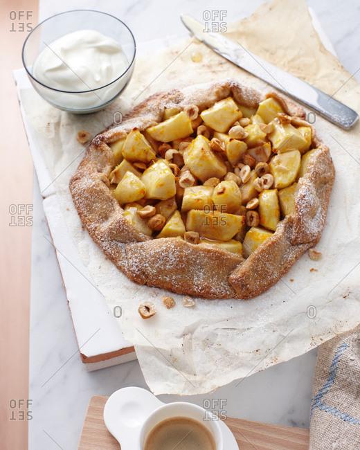 Still life of pear and hazelnut crostata
