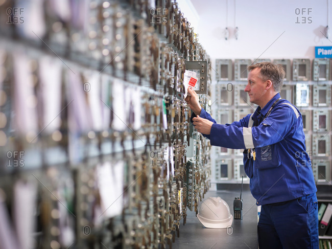 Engineer selecting equipment keys in power station