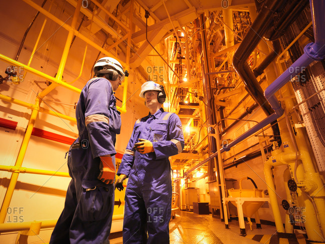 Engineers in meeting near reactor hall of nuclear power station
