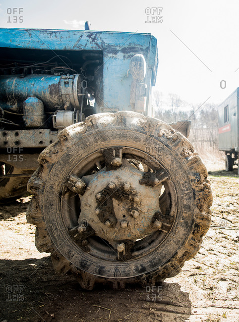 Close up of old rustic tractor in farmyard