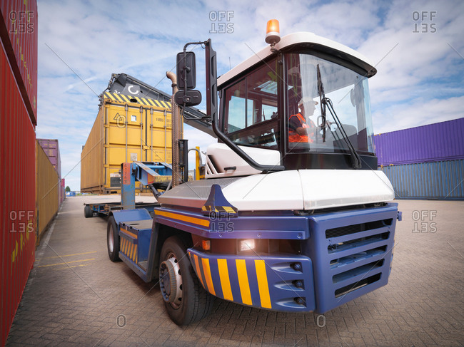 Kingston upon Hull, United Kingdom - June 26, 2014: Crane unloading shipping containers from truck in port