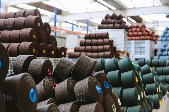 Reels of wool in storage room in woolen mill
