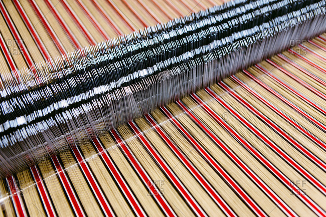 Close up of striped textile on weaving machine in woolen mill